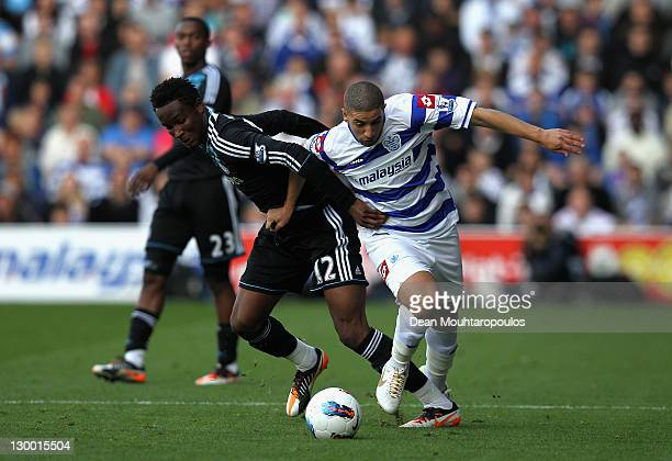 Jon Obi Mikel of Chelsea and Adel Taarabt of Queens Park Rangers battle for the ball during the Barclays Premier League match between Queens Park...