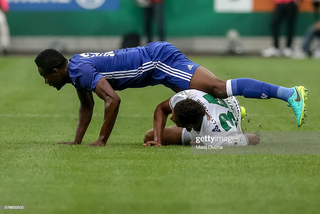 Jon Obi Mikel (L) of Chelsea competes for the ball with Joelinton (R) of Rapid Vienna during an friendly match between SK Rapid Vienna and Chelsea F.C. at Allianz Stadion on July 16, 2016 in Vienna, Austria.