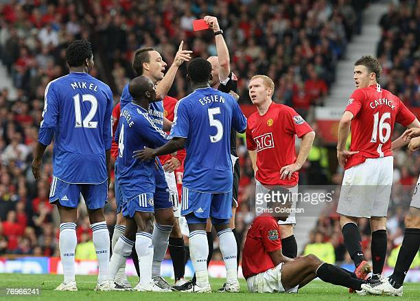 Jon Obi Mikel of Chelsea is sent off by referee Mike Dean during the Barclays FA Premier League match between Manchester United and Chelsea at Old...