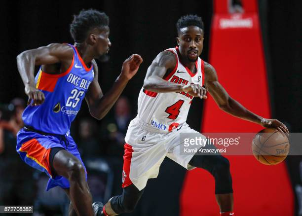 Jon Octeus of the Windy City Bulls drives to the basket against Daniel Hamilton of the Oklahoma City Blue during the second half of an NBA GLeague...