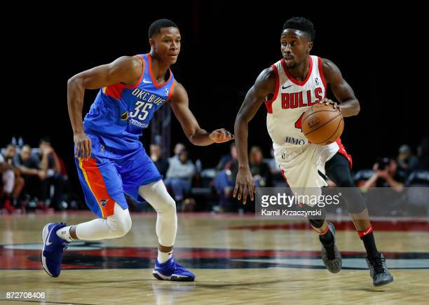 Jon Octeus of the Windy City Bulls drives to the basket against PJ Dozier of the Oklahoma City Blue during the second half of an NBA GLeague game on...
