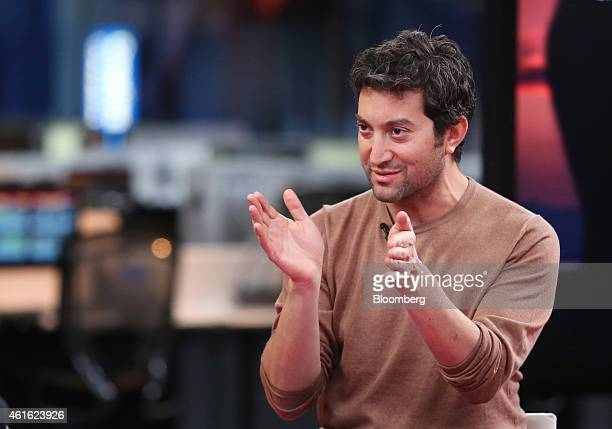 Jon Oringer billionaire and chief executive officer of Shutterstock Inc gestures as he speaks during a Bloomberg Television interview in London UK on...