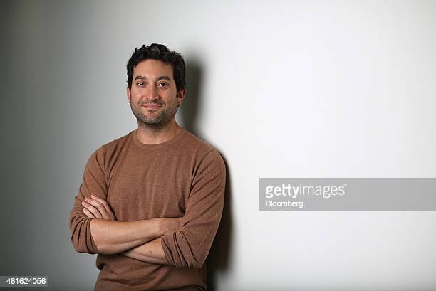 Jon Oringer billionaire and chief executive officer of Shutterstock Inc poses for a photograph following a Bloomberg Television interview in London...
