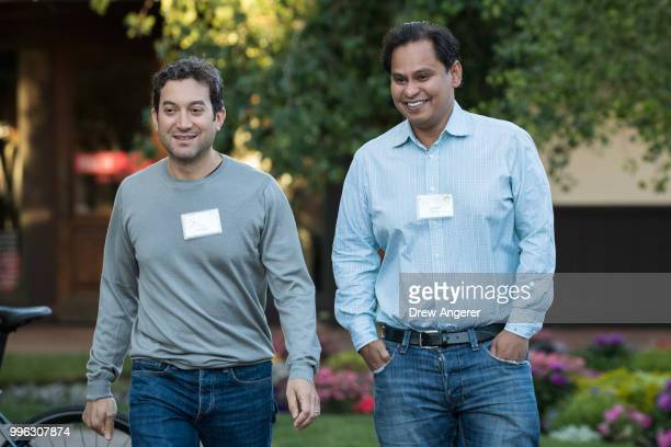 Jon Oringer chief executive officer of Shutterstock and Imran Khan chief strategy officer of Snap Inc arrive for a morning session of the annual...