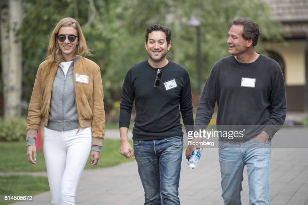 Jon Oringer founder and chief executive officer of Shutterstock Inc center with his wife Talia Oringer left and Dan Schulman president and chief...