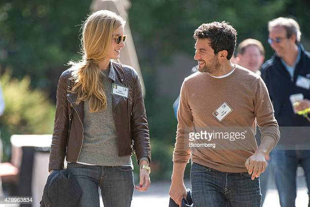 Jon Orlinger founder and chief executive officer of Shutterstock right and Talia Greismann senior product designer at Rent the Runway walk the...