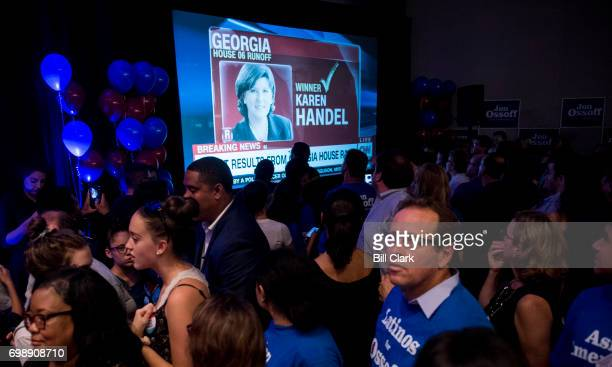 Jon Ossoff supporters at Ossoff's election night watch party are stunned as CNN calls the race for Karen Handel on June 20 2017 Democrat Ossoff faced...