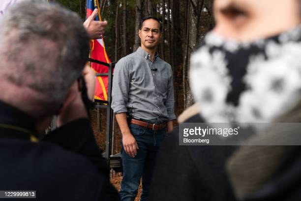 Jon Ossoff, U.S. Democratic Senate candidate, and former Health and Human Services Secretary Julin Castro speak to the media during a campaign event...