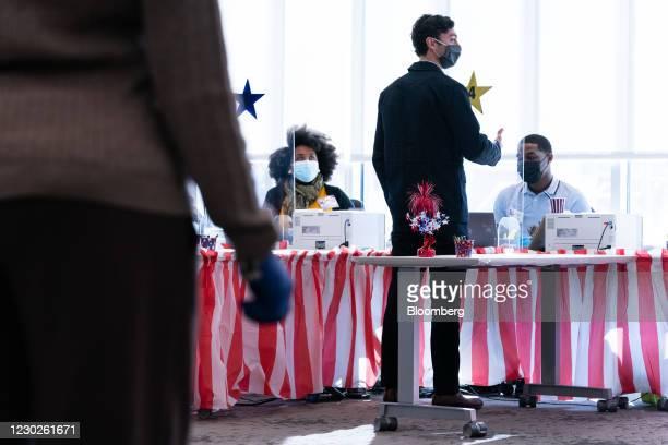 Jon Ossoff, U.S. Democratic Senate candidate, checks in at a polling location before casting his ballot for the Senate runoff election in Atlanta,...