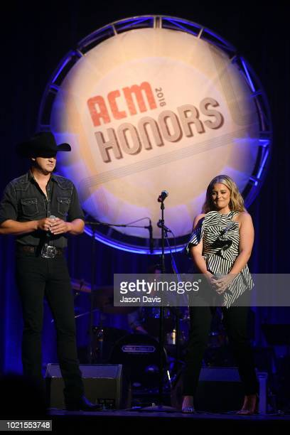 Jon Pardi and Lauren Alaina speak onstage during the 12th Annual ACM Honors at Ryman Auditorium on August 22 2018 in Nashville Tennessee