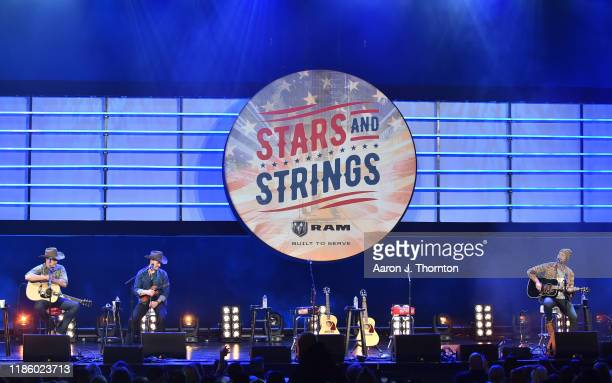 "Jon Pardi and Ryan Hurd perform on stage during ""Stars and Strings Presented by RAM Trucks Built to Serve,"" a RADIO.COM Event, at the Fox Theatre on..."