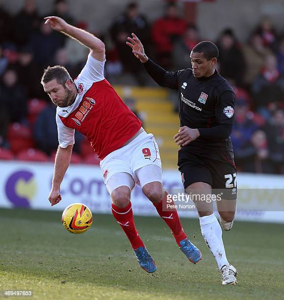 Jon Parkin of Fleetwood Town attempts to control the ball under pressure from Mathias KouoDoumbe of Northampton Town during the Sky Bet League Two...