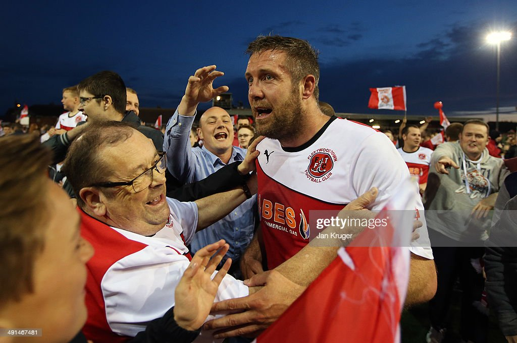 Jon Parkin of Fleetwood Town celebrates at the final whistle with fans during the Sky Bet League Two play off Semi Final second leg match between Fleetwood Town and York City at Highbury Stadium on May 16, 2014 in Fleetwood, England.