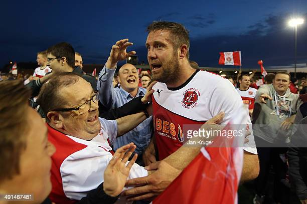 Jon Parkin of Fleetwood Town celebrates at the final whistle with fans during the Sky Bet League Two play off Semi Final second leg match between...
