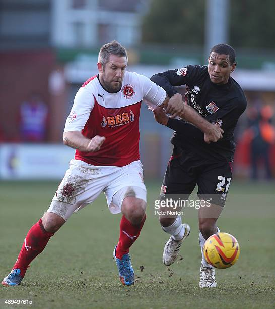 Jon Parkin of Fleetwood Town contests the ball with Mathias KouoDoumbe of Northampotn Town during the Sky Bet League Two match between Fleetwood Town...