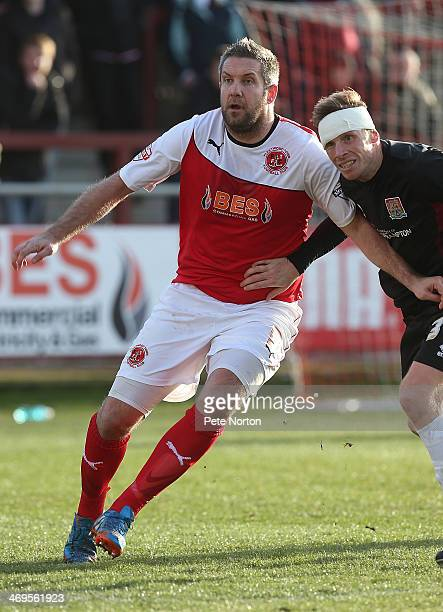 Jon Parkin of Fleetwood Town holds off Ricky Ravenhill of Northampton Town during the Sky Bet League Two match between Fleetwood Town and Northampton...