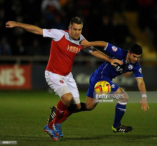 Jon Parkin of Fleetwood Town in action with Sam Morsy of Chesterfield during the Johnstone's Paint Northern Area Final between Fleetwood Town and...