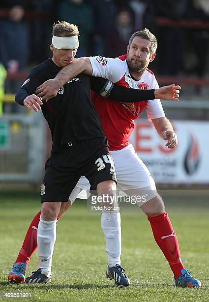 Jon Parkin of Fleetwood Town tussles with Ricky Ravenhill of Northampton Town during the Sky Bet League Two match between Fleetwood Town and...