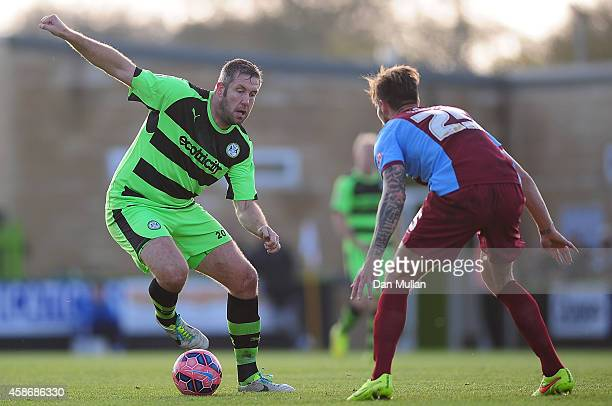 Jon Parkin of Forest Green Rovers takes on Andrew Boyce of Scunthorpe United during the FA Cup first round match between Forest Green Rovers and...
