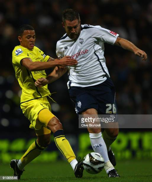 Jon Parkin of Preston North End battles for the ball with Jermaine Jenas of Tottenham Hotspur during the Carling Cup Third round match between...
