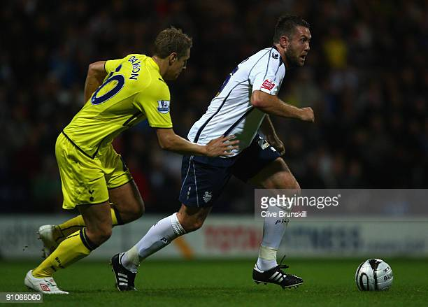Jon Parkin of Preston North End is pursued by Michael Dawson of Tottenham Hotspur during the Carling Cup Third round match between Preston North End...