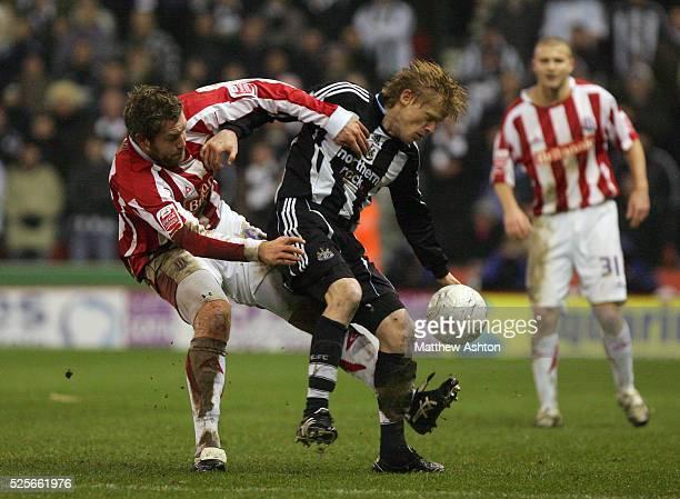 Jon Parkin of Stoke City and Damien Duff of Newcastle United