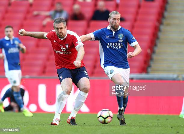 Jon Parkin of York City plays the ball under pressure from Kingsley James of Macclesfield Town during The Buildbase FA Trophy Final between York City...