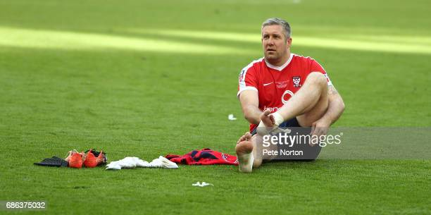 Jon Parkin of York City removes tape from his feet at the end of The Buildbase FA Trophy Final between York City and Macclesfield Town at Wembley...