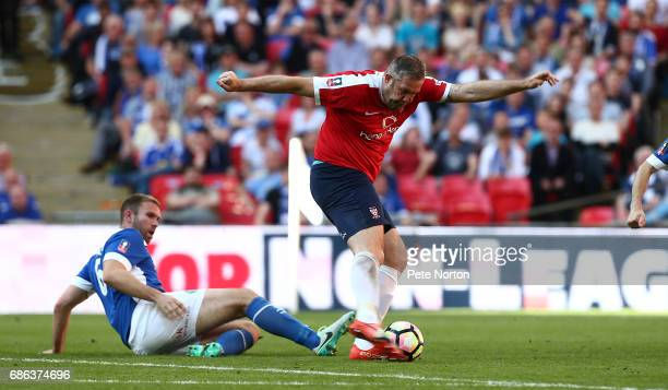 Jon Parkin of York City shoots for goal to set up his sides third goal scored by Aiden Connolly during The Buildbase FA Trophy Final between York...