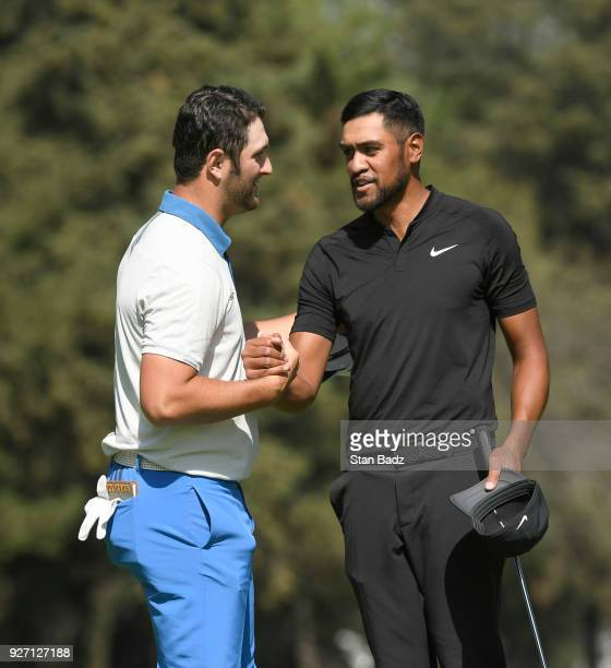 Jon Rahm and Tony Finau shake hands on the 18th green during round three of the World Golf ChampionshipsMexico Championship at Club de Golf...