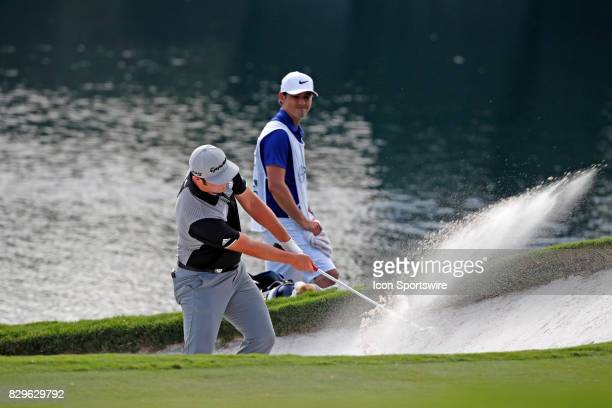 Jon Rahm hits out of a sand trap on the 14th hole during the first round of the PGA Championship on August 10 2017 at Quail Hollow Club in Charlotte...