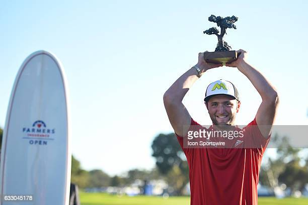 Jon Rahm holds up the trophy for winning the 2017 Farmers Insurance Open golf tournament at Torrey Pines Municipal Golf Course on January 29