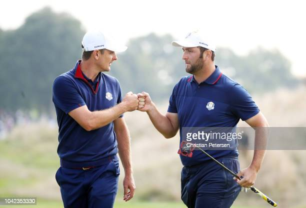 Jon Rahm of Europe and Justin Rose of Europe celebrate during the morning fourball matches of the 2018 Ryder Cup at Le Golf National on September 28...