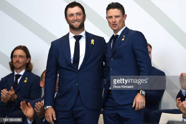 Jon Rahm of Europe and Justin Rose of Europe react after being matched against Tony Finau of the United States and Brooks Koepka of the United States...