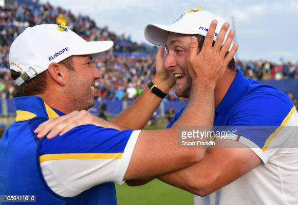 Jon Rahm of Europe and Sergio Garcia of Europe celebrate after winning The Ryder Cup during singles matches of the 2018 Ryder Cup at Le Golf National...
