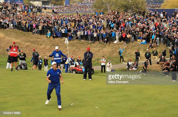 Jon Rahm of Europe celebrates winning his match on the 17th during singles matches of the 2018 Ryder Cup at Le Golf National on September 30, 2018 in...