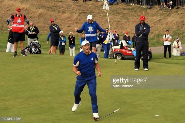 Jon Rahm of Europe celebrates winning his match on the 17th during singles matches of the 2018 Ryder Cup at Le Golf National on September 30 2018 in...