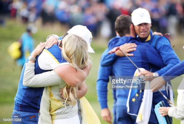 Jon Rahm of Europe celebrates winning his match with girlfriend Kelley Cahill on the 17th during singles matches of the 2018 Ryder Cup at Le Golf...