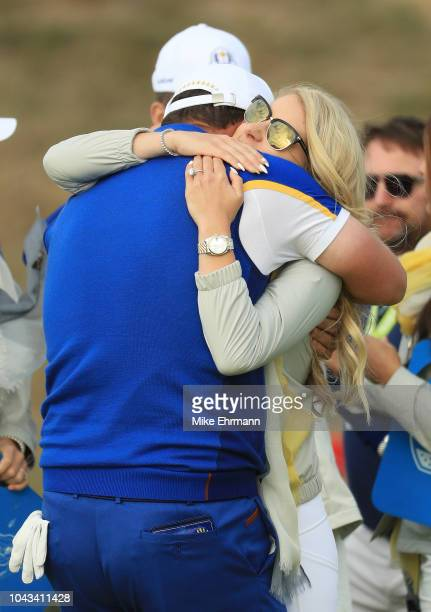 Jon Rahm of Europe celebrates winning his match with girlfriend Kelley Cahill during singles matches of the 2018 Ryder Cup at Le Golf National on...