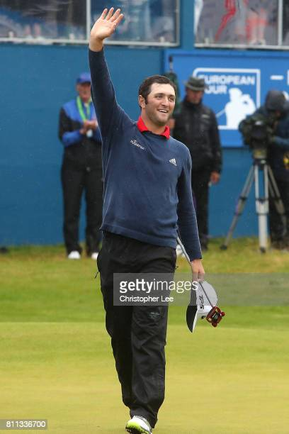Jon Rahm of Spain acknowledges the crowd on the 18th green after his victory during the final round of the Dubai Duty Free Irish Open at Portstewart...