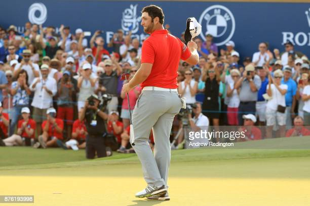 Jon Rahm of Spain acknowledges the crowd on the 18th green during the final round of the DP World Tour Championship at Jumeirah Golf Estates on...