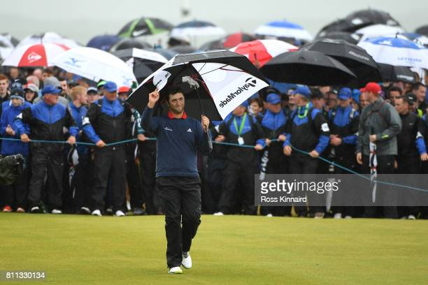 Jon Rahm of Spain acknowledges the crowd on the 18th hole during the final round of the Dubai Duty Free Irish Open at Portstewart Golf Club on July 9...
