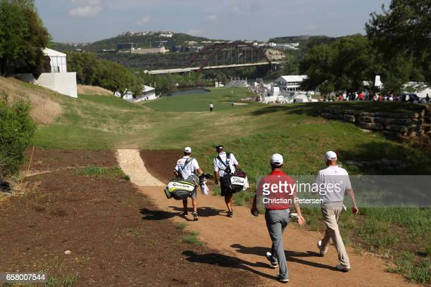 Jon Rahm of Spain and Bill Haas walk on the 12th hole of their match during the semifinals of the World Golf ChampionshipsDell Technologies Match...
