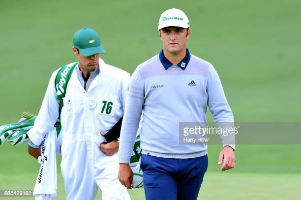 Jon Rahm of Spain and caddie Adam Hayes walk onto the second green during the first round of the 2017 Masters Tournament at Augusta National Golf...