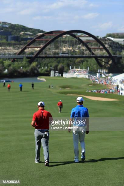 Jon Rahm of Spain and Dustin Johnson walk down the 12th hole during the final match of the World Golf Championships-Dell Technologies Match Play at...
