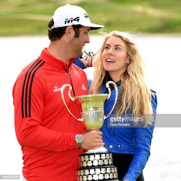 Jon Rahm of Spain and his girlfriend Kelley Cahill celebrate with winners trophy after the final round of the Open de Espana at Centro Nacional de...