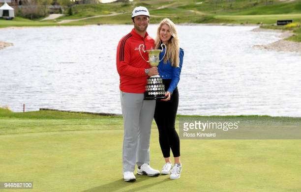 Jon Rahm of Spain and his girlfriend Kelley Cahill pose with the trophy after he won the Open de Espana during Day Four of the Open de Espana at...
