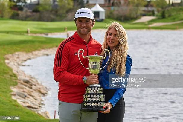 Jon Rahm of Spain and his girlfriend Kelley Cahill pose with the trophy after winning the Open de Espana during day four of Open de Espana at Centro...