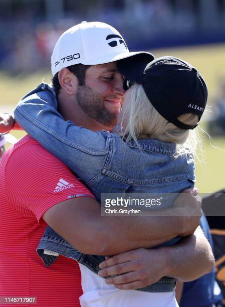 Jon Rahm of Spain and his partner Kelley Cahill celebrate after his win during the final round of the Zurich Classic at TPC Louisiana on April 28...