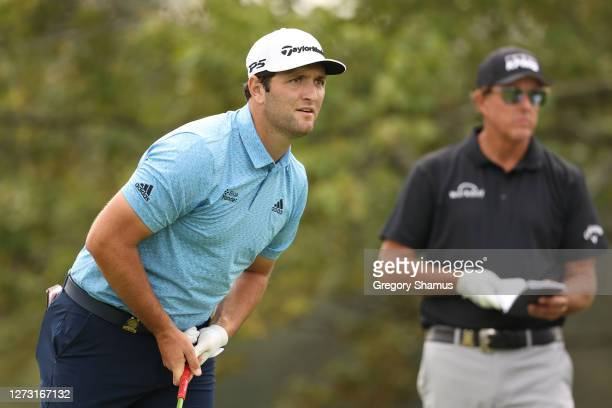 Jon Rahm of Spain and Phil Mickelson of the United States look on from the second tee during the first round of the 120th U.S. Open Championship on...